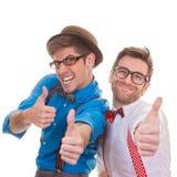 Humour, los hombres de negocios con los pulgares para arriba para el éxito Imagenes de archivo