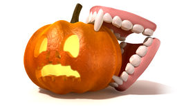 Vampire Teeth Biting Jack O'Lantern Stock Photos