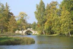 Humpback bridge in the autumn scenery. The Palace of Gatchina Park, Leningrad region Stock Photo