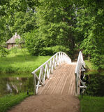 Humpback wooden bridge in the park Stock Photography
