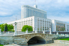 The Humpbacked bridge in Moscow. MOSCOW, RUSSIA - MAY 11, 2015: The small humpbacked bridge over non-existent riverbed Presnya, located next to the Government stock photo