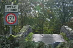 Humped back stone bridge. Stock Photography