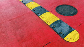 Humps or speed bumps on a red asphalt Royalty Free Stock Photography
