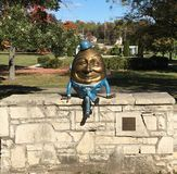 Humpty Dumpty On A Wall In St. Charles. This is a Fall picture of a Humpty Dumpty sculpture sitting on a wall in Mt. St. Mary Park located in St. Charles Stock Photos