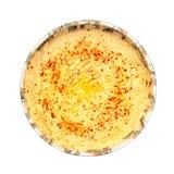 Humus bowl. Fresh home made humus bowl isolated on white Royalty Free Stock Image