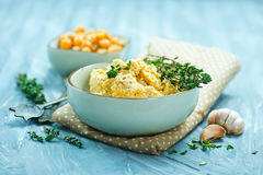 Humus. In bowl and on a table Royalty Free Stock Photos