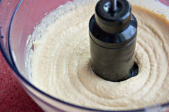 Humus in a food processor Royalty Free Stock Photo