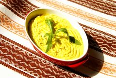 Humus paste with olive oil and chili,. Decorated with rucola Royalty Free Stock Photos