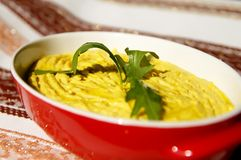 Humus paste with olive oil and chili,. Decorated with rucola Royalty Free Stock Image