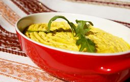 Humus paste with olive oil and chili, Stock Photography