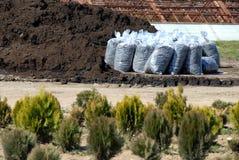 Humus in sacks. Humus in transparent sacks for gardening outdoor royalty free stock photo