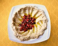 Humus. Such a simple puree of Chick peas is brought to life with the addition of some Pomegranate Seeds Royalty Free Stock Image