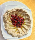 Humus. Such a simple puree of Chick peas is brought to life with the addition of some Pomegranate Seeds Royalty Free Stock Photo