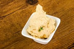 Humus. Vegetarian Humus with sesame seeds and thyme leaves Royalty Free Stock Photography
