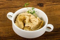 Humus. Vegetarian Humus with sesame seeds and thyme leaves Stock Photos