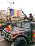 Humvee rumano del camuflaje Imagenes de archivo