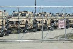 Humvees ready for war. OSHKOSH, WI - APRIL 3: A row of Oshkosh Corp military Humvees sit in a row behind a fence at Wittman Airport ready to be deployed to Royalty Free Stock Photography