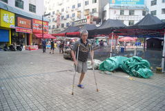 Hunan Huaihua, China: a disabled person walking Stock Images