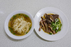 Hunan style food. Delicious Hunan style food, White noodle in clear soup with pig intestine and pig ear, ate at Taichung, Taiwan Stock Images
