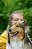 Hund und Mädchen stockbilder