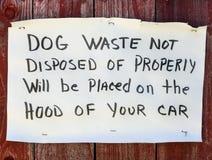 Hundeüberschüssiges Warnzeichen stockbild