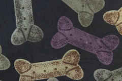 Hundeknochen-Gewebe-Hintergrund Stockfotos
