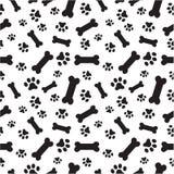Hundeknochen- und -tatzenmuster Stockfotografie