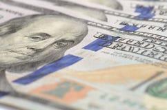 Hundert Dollar Banknotehintergrund Stockbild