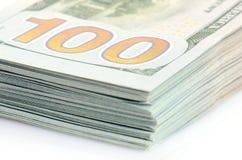 Hundert Dollar Banknotehintergrund Stockfoto