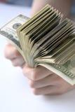 Hundert Dollar in der Hand Lizenzfreie Stockfotografie