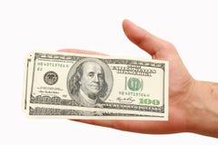 Hundert Dollar in der Hand Stockfotografie