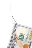 Hundert Dollarschein auf einem Haken Stockfoto