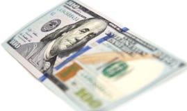 Hundert Dollarschein auf einem weißen Hintergrund Lizenzfreie Stockfotos