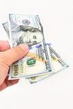 Hundert Dollarschein in der Hand Lizenzfreie Stockfotos