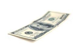 Hundert Dollarscheine auf Weiß Stockbild