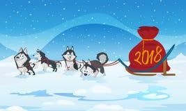 Hundeschlittenteam und chrismas rote Tasche mit Nr. 2018 Lizenzfreie Stockfotografie