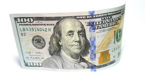 Hundra dollar och en dollarcloseup på vit bakgrund Royaltyfria Bilder