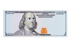 Hundra dollarsedel med ståenden av Benjamin Franklin med konstigt ögon och kopieringsutrymme för din inskrift och royaltyfri fotografi