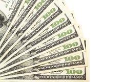 Hundra dollarsedlar som isoleras på en vit Fotografering för Bildbyråer