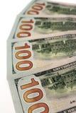 Hundra dollarsedlar vid den isolerade omvända sidan Royaltyfri Fotografi