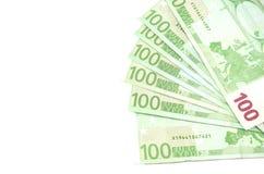 Hundra eurosedlar på en vit bakgrund royaltyfri fotografi