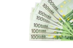 Hundra eurosedlar p? en vit bakgrund royaltyfria foton