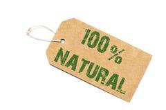 Hundra procent naturligt tecken - en pappers- prislapp på en vit Arkivbilder