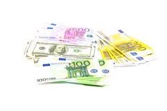 Hundratals dollar och euro 100 200 500 Arkivbild