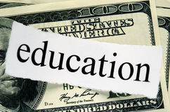Hundred american dollars. And a piece of paper with the words education Stock Image