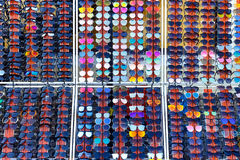 Hundred Colorful Sunglasses To Choose From. Sunglasses in Sale royalty free stock photo