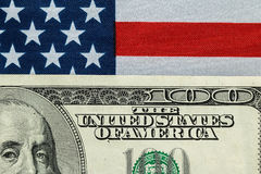 A hundred dollar on the American flag. A hundred dollar bill in front of the American flag Royalty Free Stock Images