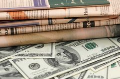 Hundred dollar bank notes and. Business newspapers Stock Photos