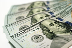 Hundred dollar bank notes isolated on the white. Hundred dollar bank notes with image of president Benjamin Franklin Stock Images
