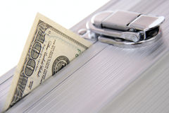 Hundred dollar banknote sticking out suitcase Stock Images